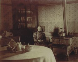Elbert Benjamine's Grandmother who largely raised him. Sitting in her kitchen at age 70.